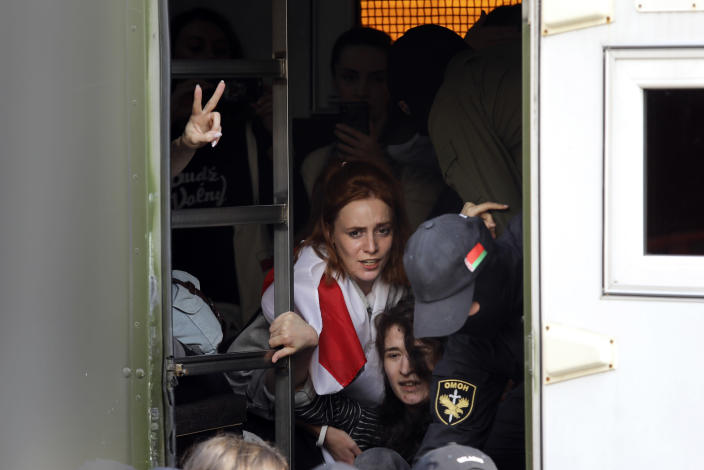 Police officers detain protesters, pushing them into a police bus during an opposition rally to protest the official presidential election results in Minsk, Belarus, Saturday, Sept. 12, 2020. Daily protests calling for the authoritarian president's resignation are now in their second month and opposition determination appears strong despite the detention of protest leaders. (AP Photo)