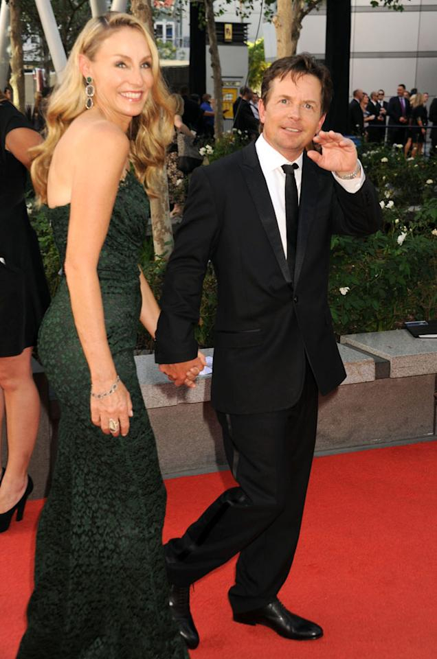 Michael J. Fox and wife Tracy Pollan arrive at the 64th Primetime Emmy Awards at the Nokia Theatre in Los Angeles on September 23, 2012.