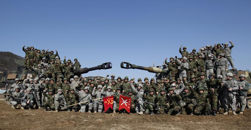 US soldiers and South Korean soldiers pose for a photo after their live firing drill at the US army's Rodriguez range in Pocheon, south of the DMZ that divides the two Koreas, in March 2012 (AFP Photo/Kim Hong-Ji)