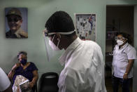 Medical personnel check on the status of people who were vaccinated with the Cuban Abdala vaccine for COVID-19 at a doctors' office in Alamar on the outskirts of Havana, Cuba, Friday, May 14, 2021. Cuba has begun to immunize people this week with its own vaccines, Abdala and Soberana 02, the only ones developed by a Latin American country. (AP Photo/Ramon Espinosa)