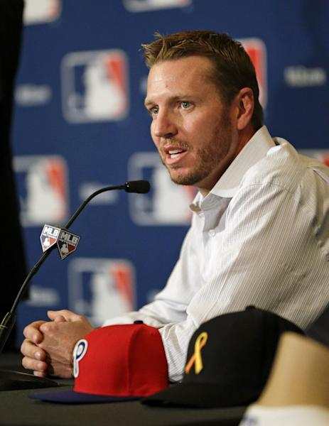 Two-time Cy Young Award winner Roy Halladay answers questions after announcing his retirement after 16 seasons in the major leagues with Toronto and Philadelphia at the MLB winter meetings in Lake Buena Vista, Fla., Monday, Dec. 9, 2013. (AP Photo/John Raoux)