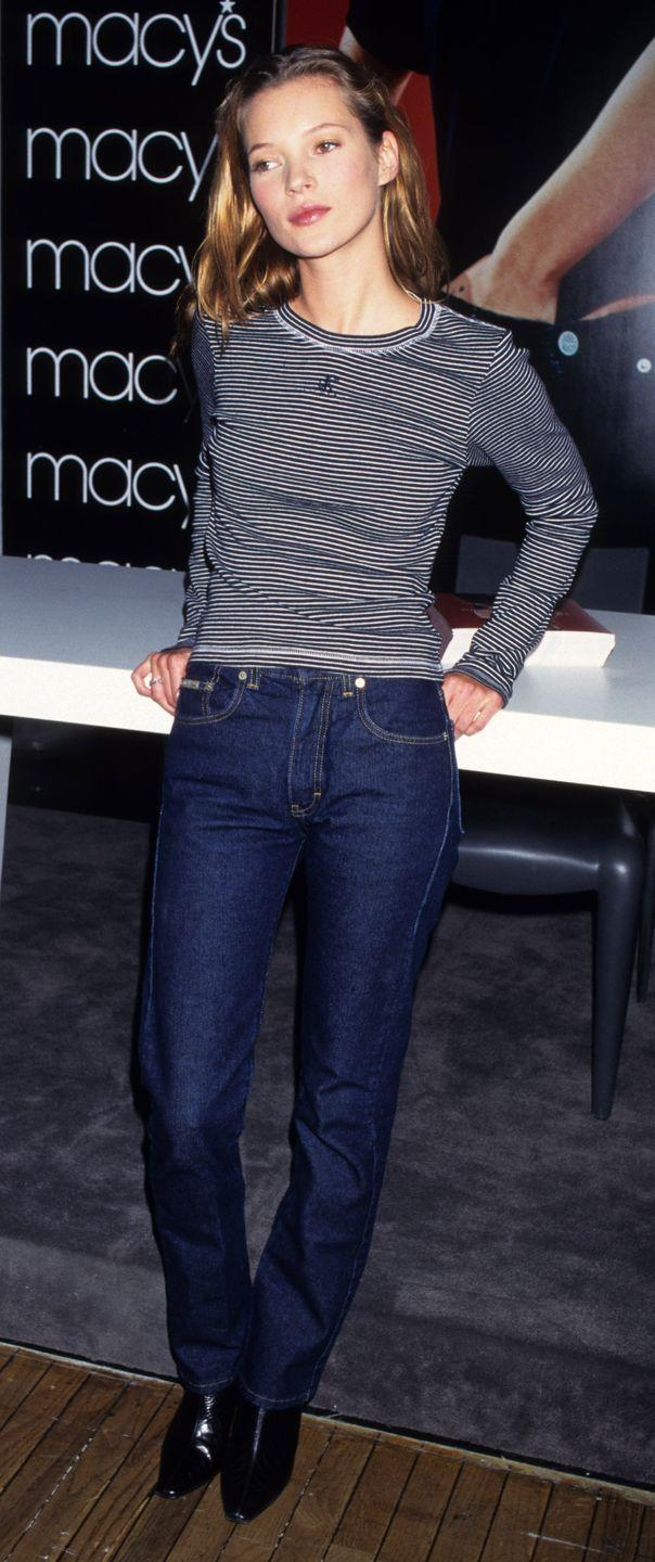 <p>Kate Moss promoting Calvin Klein jeans at an event. Jeans were starting to become a little more stretchy and less stiff.</p>