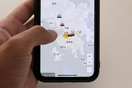 The HKmap.live App is pictured on a phone screen in this photo illustration in Hong Kong