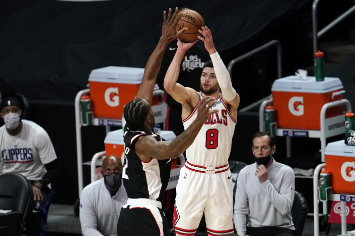 Chicago Bulls guard Zach LaVine (8) shoots over Los Angeles Clippers forward Kawhi Leonard (2) during the first half of an NBA basketball game Sunday, Jan. 10, 2021, in Los Angeles. (AP Photo/Marcio Jose Sanchez)