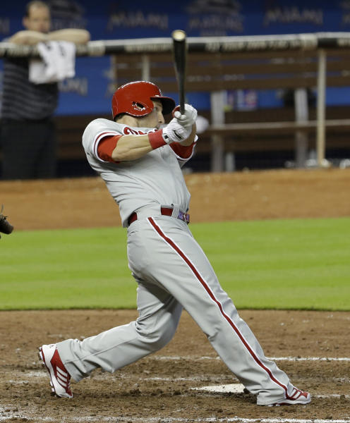 Philadelphia Phillies' Laynce Nix follows through on his game-winning solo home run against the Miami Marlins during the ninth inning of a baseball game in Miami, Sunday, April 14, 2013. The Phillies won 2-1. (AP Photo/Alan Diaz)