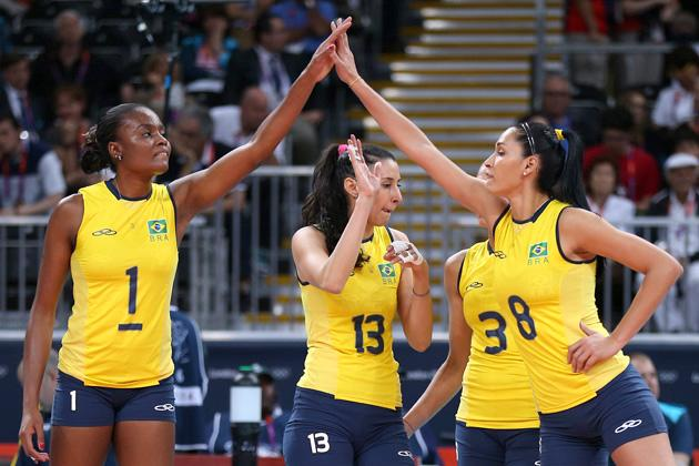 LONDON, ENGLAND - JULY 30:  Brazil players high five in the Women's Volleyball Preliminary match between the United States and Brazil on Day 3 of the London 2012 Olympic Games at Earls Court on July 30, 2012 in London, England.  (Photo by Elsa/Getty Images)