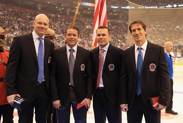 TORONTO, ON - NOVEMBER 11: (L-R) Mats Sundin, Pavel Bure, Adam Oates, and Joe Sakic are presented with Hall of Fame jackets prior to the Hockey Hall of Fame Legends Game at the Air Canada Centre on November 11, 2012 in Toronto, Canada. All four are former NHL players who will be inducted into the Hockey Hall of Fame at a ceremony at the Hall on November 12. (Photo by Bruce Bennett/Getty Images)