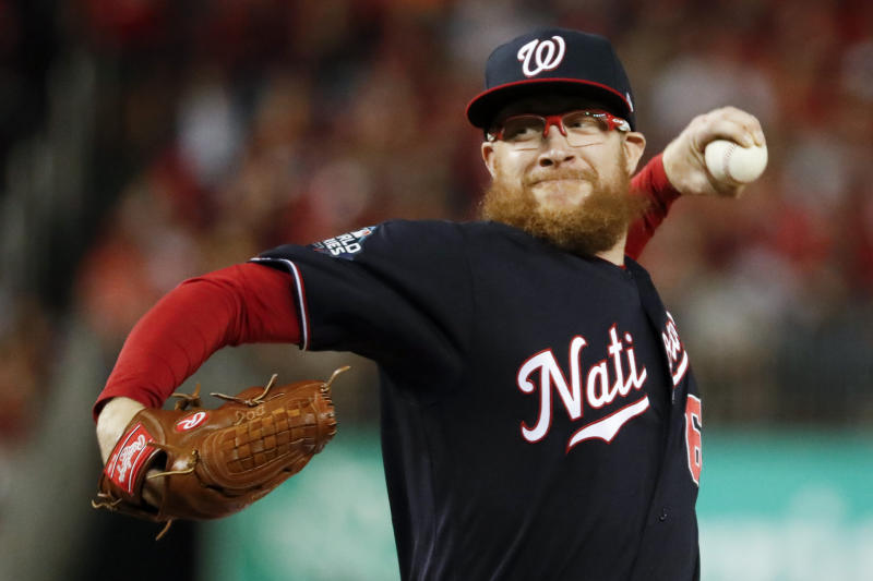 Washington Nationals relief pitcher Sean Doolittle throws during the seventh inning of Game 5 of the baseball World Series against the Houston Astros Sunday, Oct. 27, 2019, in Washington. (AP Photo/Jeff Roberson)