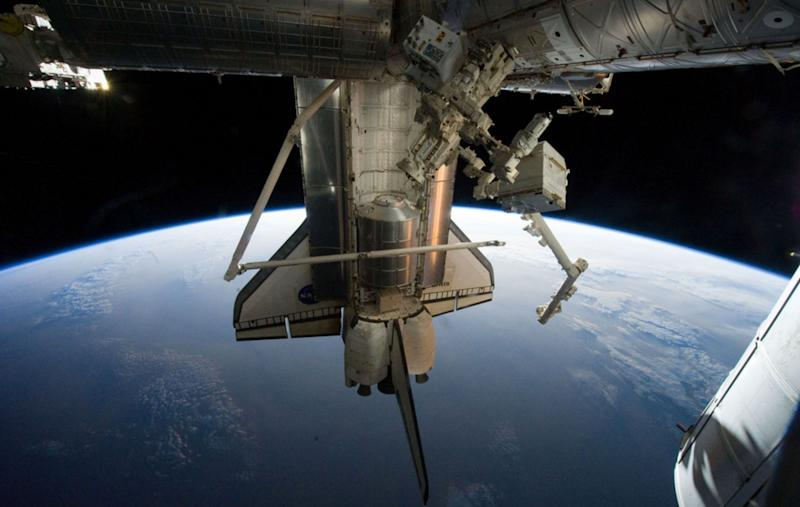 NASA image acquired July 19, 2011 - Silhouetted against the Earth, Atlantis flies into the rising Sun in this photograph taken by an astronaut on the International Space Station on July 19, 2011. On July 20, the shuttle undocked from the station for the final time and began preparations to return home. During their 13 days in space, the shuttle astronauts supplied the International Space Station with a new logistics module, tested tools, technologies, and techniques to refuel satellites in space, and collected old equipment from the space station. Credit: NASA Earth Observatory
