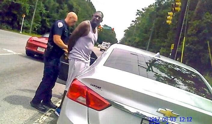 The bodycam of Bluffton Police Officer Amber Swinehamer shows fellow officer Cody Kirkman putting handcuffs on Bluffton resident Teddy Ellis on Aug. 3, 2017, after an Automatic License Plate Reader alerted Kirkman that Ellis' vehicle registration was suspended.