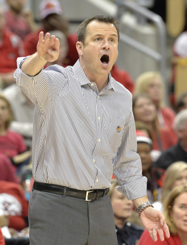 Louisville head coach Jeff Walz shouts instructions to his team during the first half in a regional semifinal game against LSU at the NCAA women's college basketball tournament on Sunday, March 30, 2014, in Louisville, Ky. (AP Photo/Timothy D. Easley)