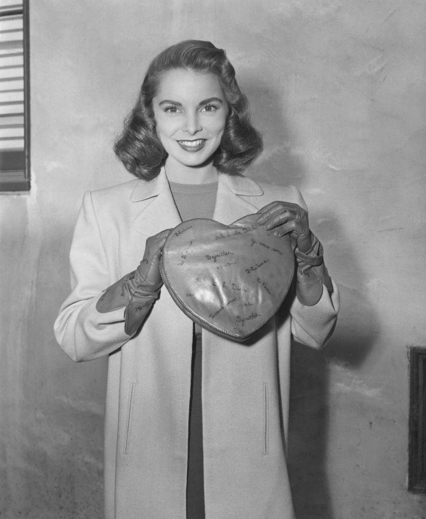 <p>As seen here, actress Janet Leigh shows the camera some love as she poses with a heart-shaped purse. The California native made her big-screen debut in <em>The Romance of Rosy Ridge</em> (1947) and later went on to star in <em>Little Women</em> (1949), <em>Touch of Evil</em> (1958) and <em>Psycho</em> (1960).</p>