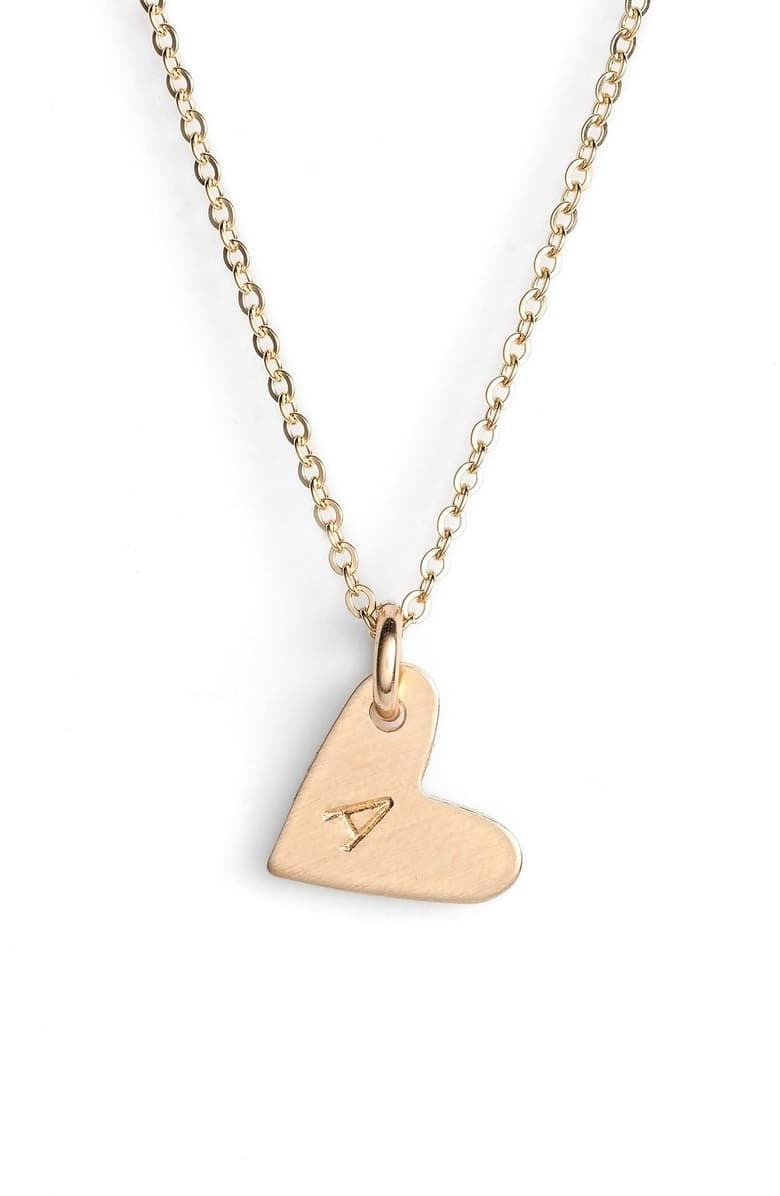 "<p>Make like Meghan Markle and show your love with this <a href=""https://www.popsugar.com/buy/Nashelle-14k-Gold-Fill-Initial-Mini-Heart-Pendant-Necklace-494336?p_name=Nashelle%2014k-Gold%20Fill%20Initial%20Mini%20Heart%20Pendant%20Necklace&retailer=shop.nordstrom.com&pid=494336&price=45&evar1=fab%3Aus&evar9=44353153&evar98=https%3A%2F%2Fwww.popsugar.com%2Ffashion%2Fphoto-gallery%2F44353153%2Fimage%2F47015401%2FNashelle-14k-Gold-Fill-Initial-Mini-Heart-Pendant-Necklace&list1=shopping%2Cnordstrom%2Choliday%2Cgift%20guide%2Clast-minute%20gifts%2Cfashion%20gifts%2Cgifts%20for%20women&prop13=api&pdata=1"" rel=""nofollow noopener"" class=""link rapid-noclick-resp"" target=""_blank"" data-ylk=""slk:Nashelle 14k-Gold Fill Initial Mini Heart Pendant Necklace"">Nashelle 14k-Gold Fill Initial Mini Heart Pendant Necklace</a> ($45).</p>"