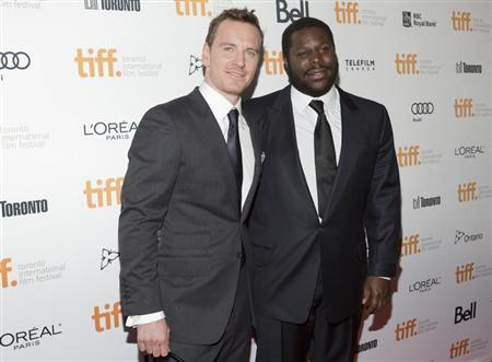 "Steve McQueen arrives with Michael Fassbender for film screening of ""12 Years a Slave"" at Toronto International Film Festival in Toronto"