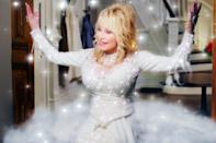 "<p>Dolly Parton, <a href=""https://www.popsugar.com/celebrity/dolly-parton-covid-19-research-fund-moderna-vaccine-47977255"" class=""link rapid-noclick-resp"" rel=""nofollow noopener"" target=""_blank"" data-ylk=""slk:vaccine investor"">vaccine investor</a> and country music extraordinaire, plays a literal Christmas angel who tries to change the ways of a greedy woman named Regina Fuller (Christine Baranski) in this Debbie Allen feature. After her father's death, Regina returns home to evict residents and sell the land to a mall developer. The film encompasses camp, love, and music for a cup of delightful holiday cheer.</p> <p><a href=""http://www.netflix.com/title/81128934"" class=""link rapid-noclick-resp"" rel=""nofollow noopener"" target=""_blank"" data-ylk=""slk:Watch Dolly Parton's Christmas on the Square on Netflix on Nov. 22."">Watch <strong>Dolly Parton's Christmas on the Square</strong> on Netflix on Nov. 22.</a></p>"