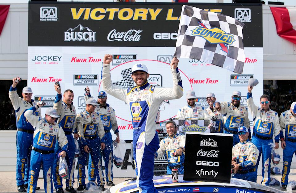 Chase Elliott, center, celebrates with his Hendrick Motorsports crew after winning the Jockey Made in America 250 Presented by Kwik Trip, Sunday at Road America.