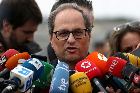FILE PHOTO: Newly elected Catalan regional leader Quim Torra speaks to reporters outside the Estremera prison where he visited former Catalan cabinet members Oriol Junqueras, Jordi Turull, Joaquim Forn, Josep Rull and Raul Romeva who are jailed there pending trial on charges of sedition, rebellion and misappropriation of funds, in Estremera, Spain, May 21, 2018.  REUTERS/Sergio Perez -/File Photo