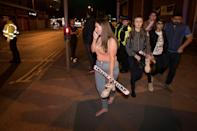 <p>Concert goers react after fleeing the Manchester Arena in northern England where U.S. singer Ariana Grande had been performing in Manchester, Britain, May 22, 2017. (Jon Super/Reuters) </p>