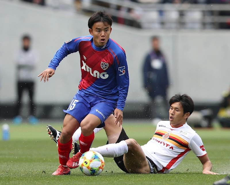 Japan's 17-year-old Takefusa Kubo (left) leaves a tackler in his wake while playing for FC Tokyo against Nagoya Grampus Eight in the J-League