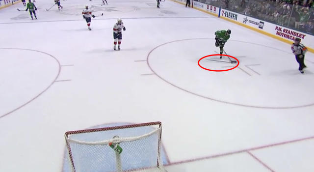 Florida's Mike Hoffman tossed his stick at Dallas' Alex Radulov while he shot at an empty net on Tuesday night. (Screenshot//NHL.com)