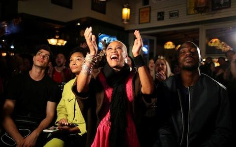 People cheer during a royal wedding watching party for the wedding of Britain's Prince Harry and Meghan Markle at the Cat & Fiddle pub in Hollywood, Los Angeles - Credit: Reuters