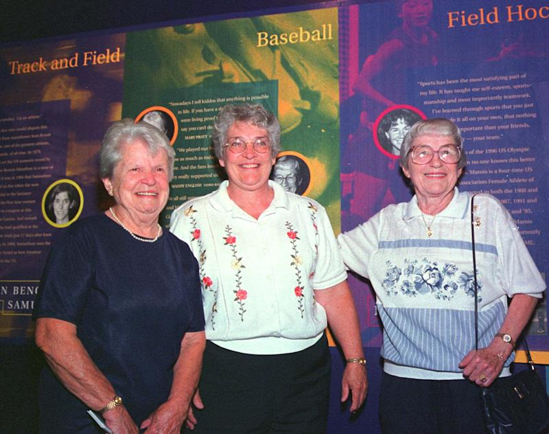 Former women's professional baseball players Mary Pratt, left, of Quincy, Mass., and Maddy English, right, of Everett, Mass., are joined by their friend Marie Cronin, center, at the opening, Tuesday, Aug. 3, 1999, of the New England Women's Sports Hall of Fame in Saugus, Mass. Pratt and English were members of the All-American Girls Professional Baseball League in the 1940s. The musuem honors New England women athletes in every major sport. (AP Photo/Steven Tackeff)