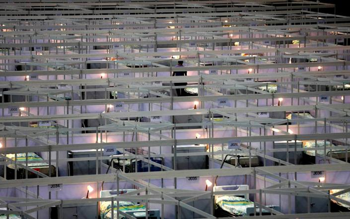 Rows of beds at the temporary field hospital - AP Photo/Kin Cheung
