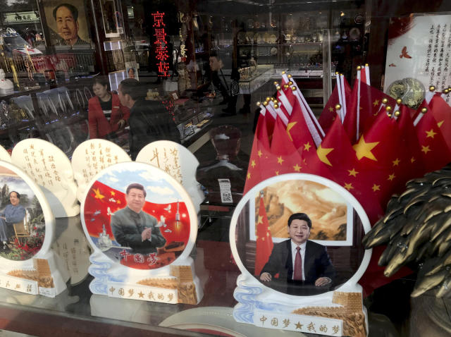 Memorabilia featuring Chinese President Xi Jinping are displayed at a souvenir shop in Beijing, Monday, Feb. 26, 2018. (AP Photo/Ng Han Guan)