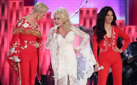 "Katy Perry, from left, Dolly Parton and Kacey Musgraves perform ""Here You Come Again"" - Credit: AP"