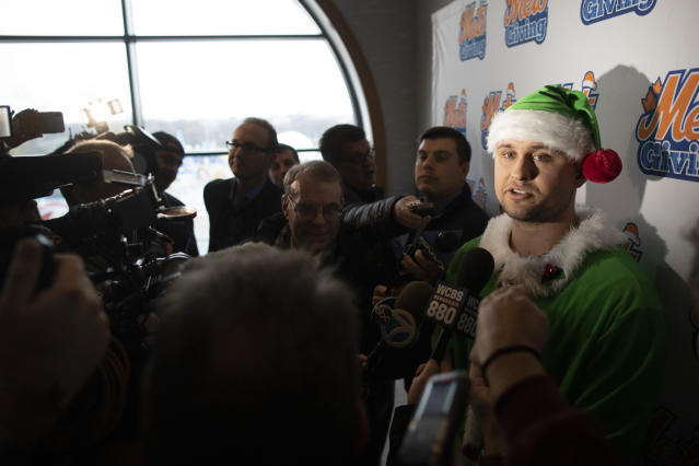 New York Mets infielder J.D. Davis, dressed as an Elf, talks to reporters during the team's annual Kids Holiday Party, Wednesday, Dec. 4, 2019, in New York. (AP Photo/Mary Altaffer)