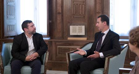 Syria's President Bashar al-Assad (R) meets with European Parliament delegation headed by Javier Couso (L), vice-president of the European parliamentary committee on foreign affairs, in Damascus, Syria, in this handout picture provided by SANA on July 10, 2016. SANA/Handout via REUTERS