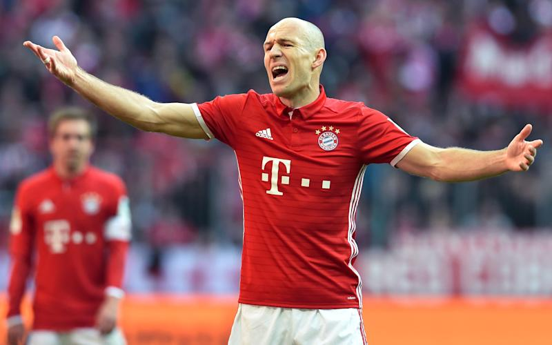 Bayern Munich's Dutch midfielder Arjen Robben gestures during the German First division Bundesliga football match Bayern Munich vs Eintracht Frankfurt in Munich, southern Germany, on March 11, 2017. / AFP PHOTO / Christof STACHE / RESTRICTIONS: DURING MATCH TIME: DFL RULES TO LIMIT THE ONLINE USAGE TO 15 PICTURES PER MATCH AND FORBID IMAGE SEQUENCES TO SIMULATE VIDEO. == RESTRICTED TO EDITORIAL USE == FOR FURTHER QUERIES PLEASE CONTACT DFL DIRECTLY AT + 49 69 650050 CHRISTOF STACHE/AFP/Getty Images - Credit: CHRISTOF STACHE/AFP/Getty