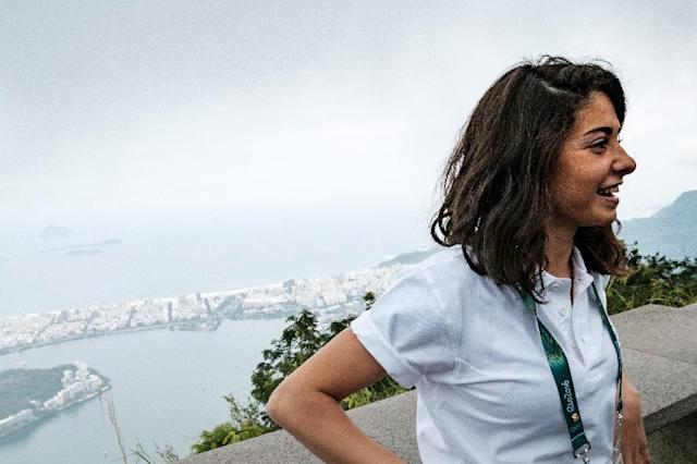Syria's swimmer Yusra Mardini based in Germany for the Refugee Olympic Team (ROT) visits the statue of Christ the Redeemer, ahead of Rio 2016 Olympic games (AFP Photo/Yasuyoshi Chiba)