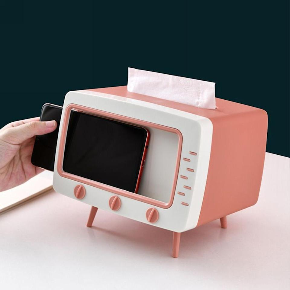 <p>How smart is this <span>Tissue Box and Phone Holder</span> ($13, originally $17)? You'll find yourself using it every day.</p>