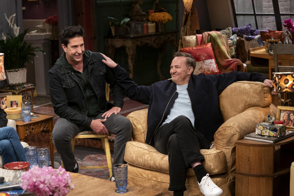 """This image provided by HBO Max shows David Schwimmer, left, and Matthew Perry in a scene from the """"Friends"""" reunion special. (Terence Patrick/HBO Max via AP)"""