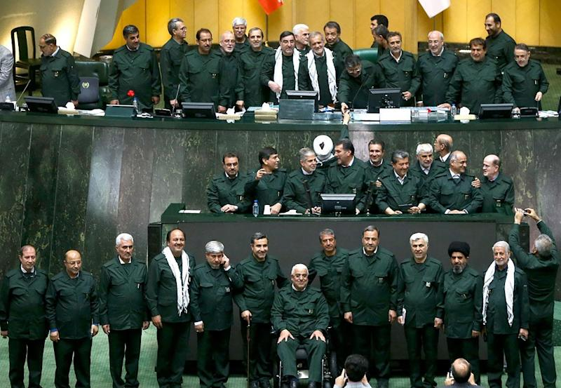 "Iranian MPs wear the outfit of the Islamic Revolutionary Guards Corp during a parliamentary session in Tehran after the US designated the IRGC a ""terrorist organisation"""