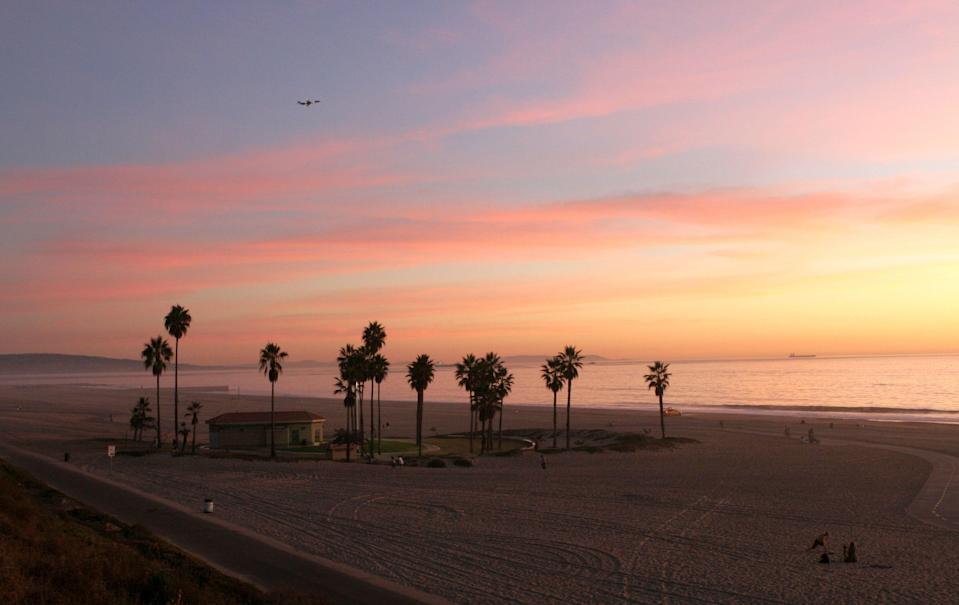"""<p><strong>Give us the wide-angle view: what kind of beach are we talking about?</strong><br> Dockweiler State Beach is a long, sandy beach just to the south of <a href=""""https://www.cntraveler.com/story/amex-centurion-lounge-lax-is-its-biggest-yet?mbid=synd_yahoo_rss"""" rel=""""nofollow noopener"""" target=""""_blank"""" data-ylk=""""slk:LAX"""" class=""""link rapid-noclick-resp"""">LAX</a>. Because of its proximity to the airport, you'll hear a constant stream of planes overhead as you swim in the cool blue water, bike on the 3.7 mile bike path, hang glide, or have a barbecue at one of the beach's 40 fire rings.</p> <p><strong>How accessible is it?</strong><br> Located just off the <a href=""""https://www.cntraveler.com/story/3-days-in-monterey-and-big-sur?mbid=synd_yahoo_rss"""" rel=""""nofollow noopener"""" target=""""_blank"""" data-ylk=""""slk:Pacific Coast Highway"""" class=""""link rapid-noclick-resp"""">Pacific Coast Highway</a> to the south of LAX, Dockweiler is one of the more easily accessible beaches in L.A. Parking is plentiful and $6 and $13 a car depending on the season.</p> <p><strong>Decent services and facilities, would you say?</strong><br> Dockweiler was known in the '60s as a hang gliding hotspot, aided by a nearby 25-foot hill, tame breezes, and a cushy sand landing zone. City officials banned the sport in the '80s, but enthusiasts lobbied for its return, and now it's come back full force with the state-of-the-art Dockweiler Hang Gliding Center. Lessons from Windsports Hang Gliding start at $99 for a four-launch mini-lesson to $160 for a seven-launch full lesson.</p> <p><strong>How's the actual beach stuff—sand and surf?</strong><br> What makes Dockweiler such a great hang gliding spot is what makes it a nice swimming zone, too—the gentler breezes means stiller water to paddle out in. The water itself is crystal clear, even as you venture out. The lack of choppy waves also means there's not a whole lot of surfing.</p> <p><strong>Can we go barefoot?</strong><br> The soft sands of Dockweiler make for """