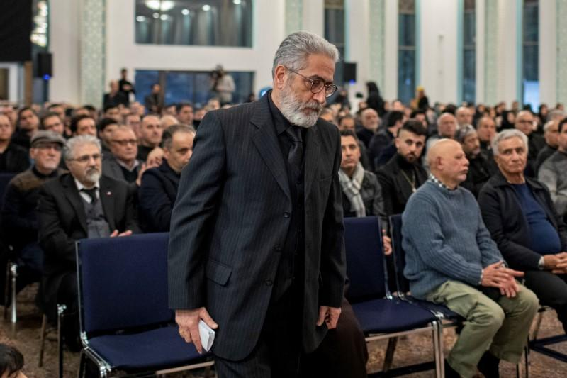 Mourners attend a memorial for the victims of a Ukrainian passenger jet which was shot down in Iran