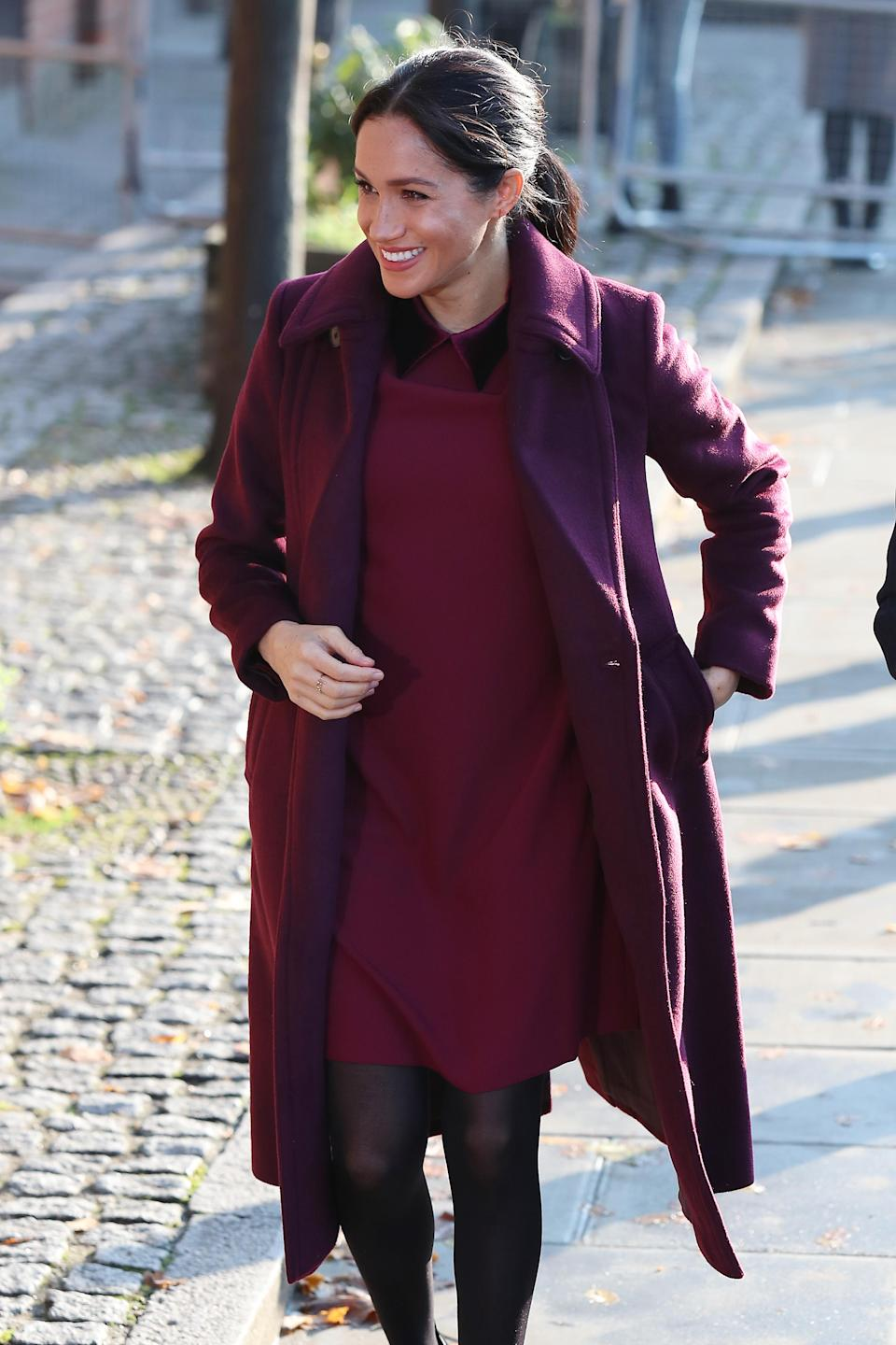 <p>The mother-to-be visited the Hubb Community Kitchen on November 21 to see how proceeds from the Together cookbook are making a difference. For the regal outing, she dressed her bump in a £178 Club Monaco dress with a matching plum-hued coat. <em>[Photo: Getty]</em> </p>
