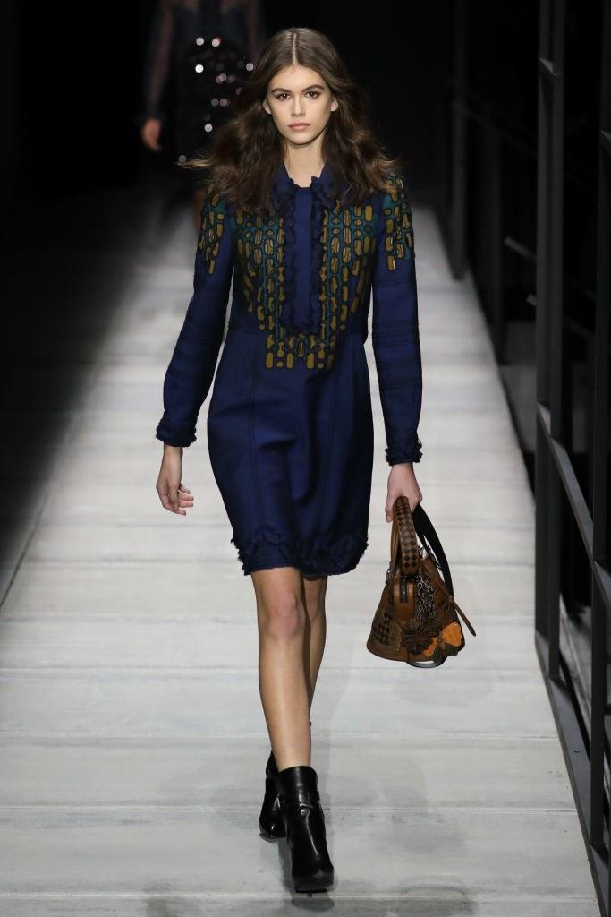 Kaia Gerber walks the runway at Bottega Veneta Fall/Winter 2018 Collection at the American Stock Exchange on February 9, 2018 in New York City. Photo courtesy Getty Images.