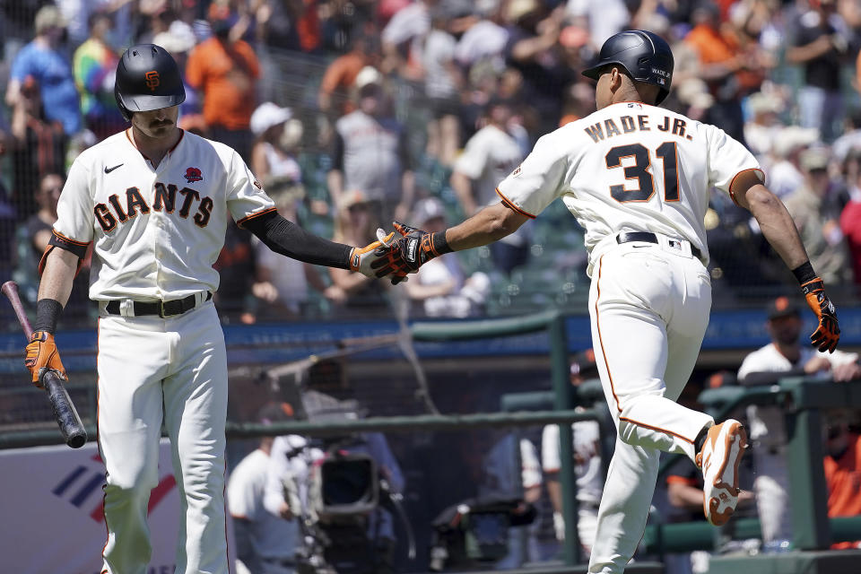 San Francisco Giants' LaMonte Wade Jr. (31) is congratulated by teammate Mike Yastrzemski, left, after hitting a solo home run against the Los Angeles Angels during the fifth inning of a baseball game Monday, May 31, 2021, in San Francisco. (AP Photo/Tony Avelar)