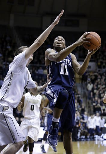 Penn State guard Jermaine Marshall, right, shoots over Purdue forward Donnie Hale in the first half of an NCAA college basketball game in West Lafayette, Ind., Sunday, Jan. 13, 2013. (AP Photo/Michael Conroy)