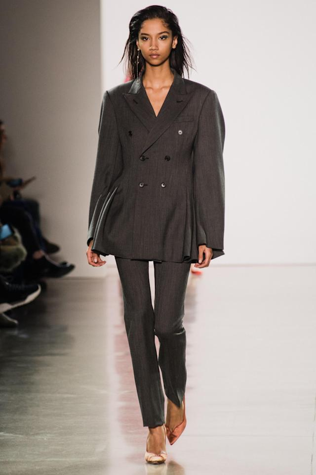 <p>Model wears a gray double-breasted pantsuit at the fall 2018 Matthew Adams Dolan show. (Photo: Getty Images) </p>