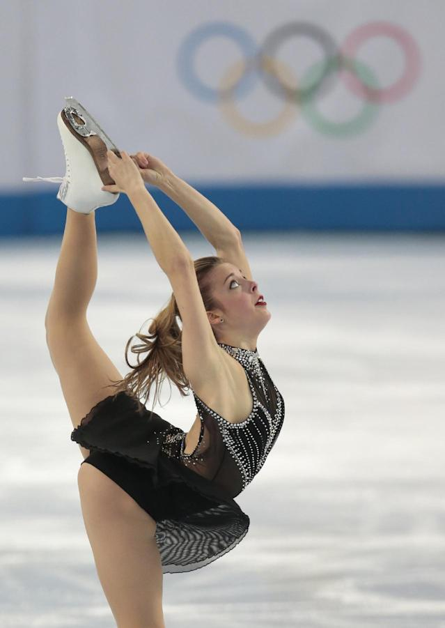 Ashley Wagner of the United States competes in the women's team short program figure skating competition at the Iceberg Skating Palace during the 2014 Winter Olympics, Saturday, Feb. 8, 2014, in Sochi, Russia