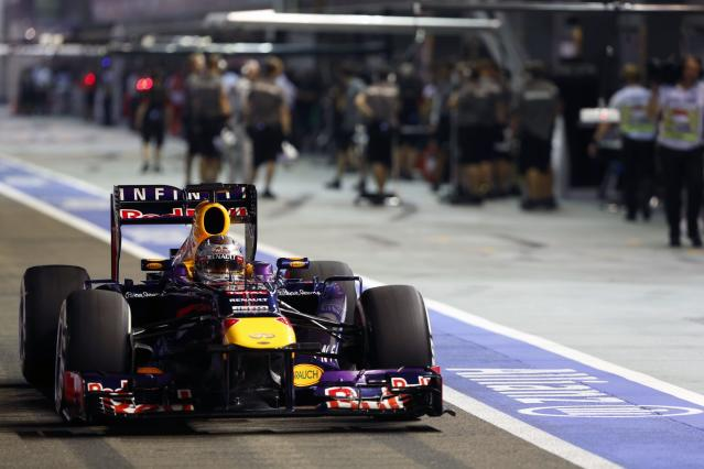 Red Bull Formula One driver Sebastian Vettel of Germany drives in the pit lane during the qualifying session of the Singapore Formula One Grand Prix September 21, 2013. REUTERS/Pablo Sanchez (SINGAPORE - Tags: SPORT MOTORSPORT F1)