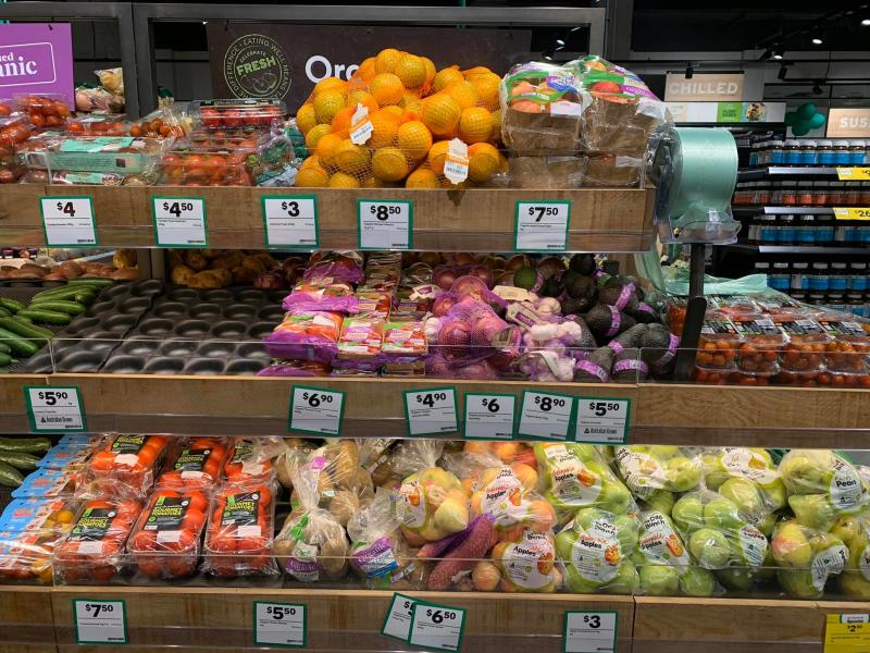 Fruit and veg are seen wrapped in plastic on a shelf at Woolworths in Roseberry.