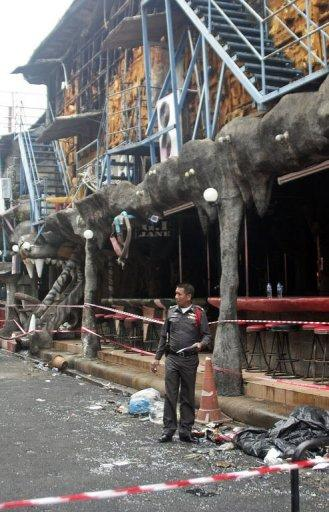 A Thai policeman stands outside the Tiger disco after a fire ripped through the nightclub overnight in the seaside resort of Patong on Thailand's southern island of Phuket on August 17, 2012