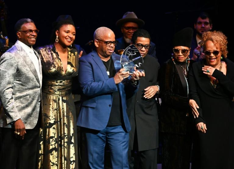 Pianist and keyboardist Herbie Hancock (C-R) presents Terence Blanchard (C-L) with the Herbie Hancock Institute of Jazz 2019 Founder's Award (AFP Photo/EVA HAMBACH)