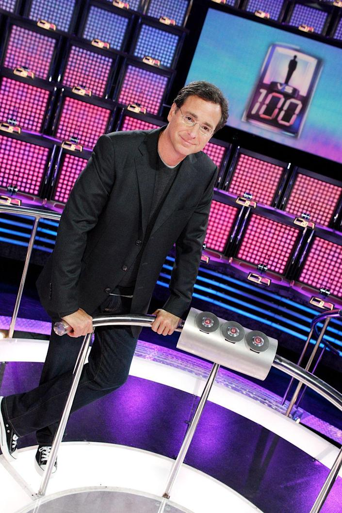 """<p>The NBC trivia game show debuted in 2006 with Bob Saget as the host. One player competed against 100 members of the """"mob"""" on the wall, slowly knocking out members of the group. If a contestant successfully eliminated all 100 people by answering questions correctly, the contestant would earn $1,000,000. A wrong answer would end the game. After its two year run with Saget, GSN revived the show in 2010 with Carrie Ann Inaba hosting.</p>"""