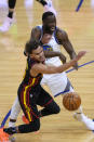 Atlanta Hawks guard Trae Young (11) collides with Golden State Warriors forward Draymond Green (23) during the first half of an NBA basketball game in San Francisco, Friday, March 26, 2021. (AP Photo/Tony Avelar)